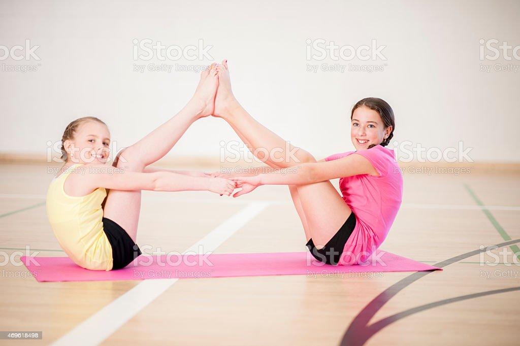 Two Girls Yoga stock photo