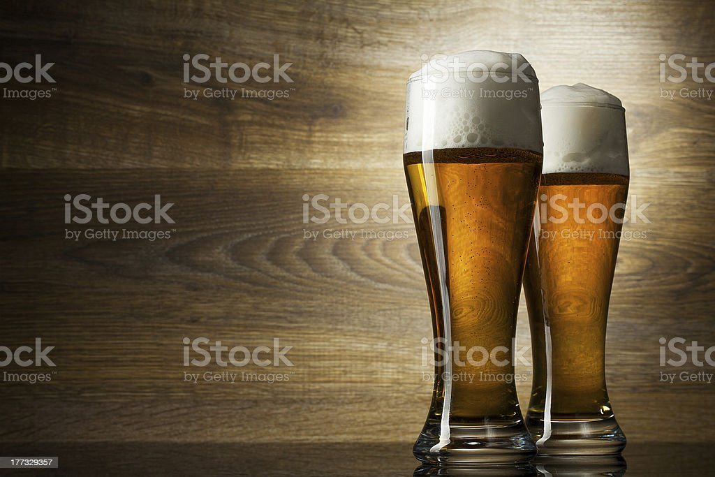Two glass beer on wood background with copyspace stock photo