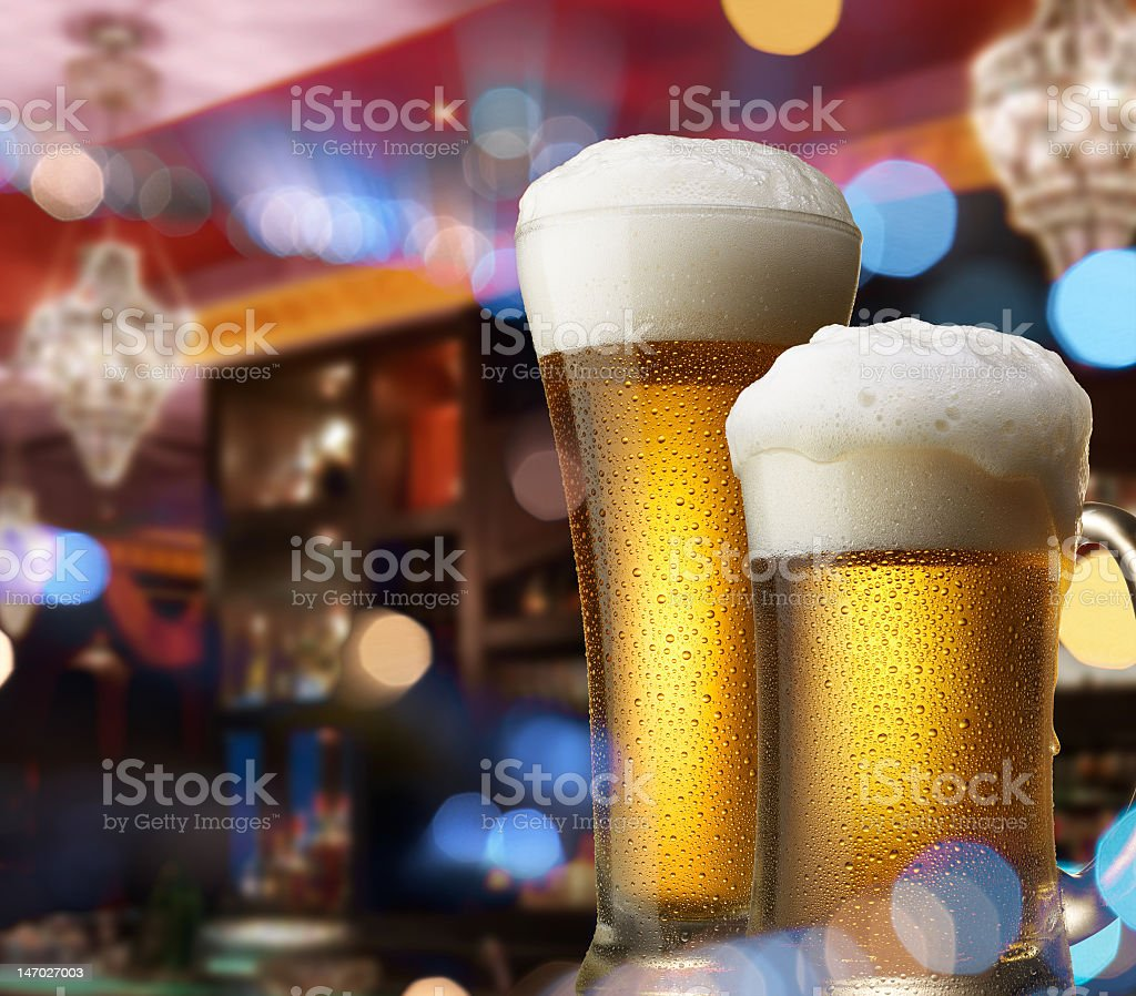 Two glass beers on a bar counter stock photo