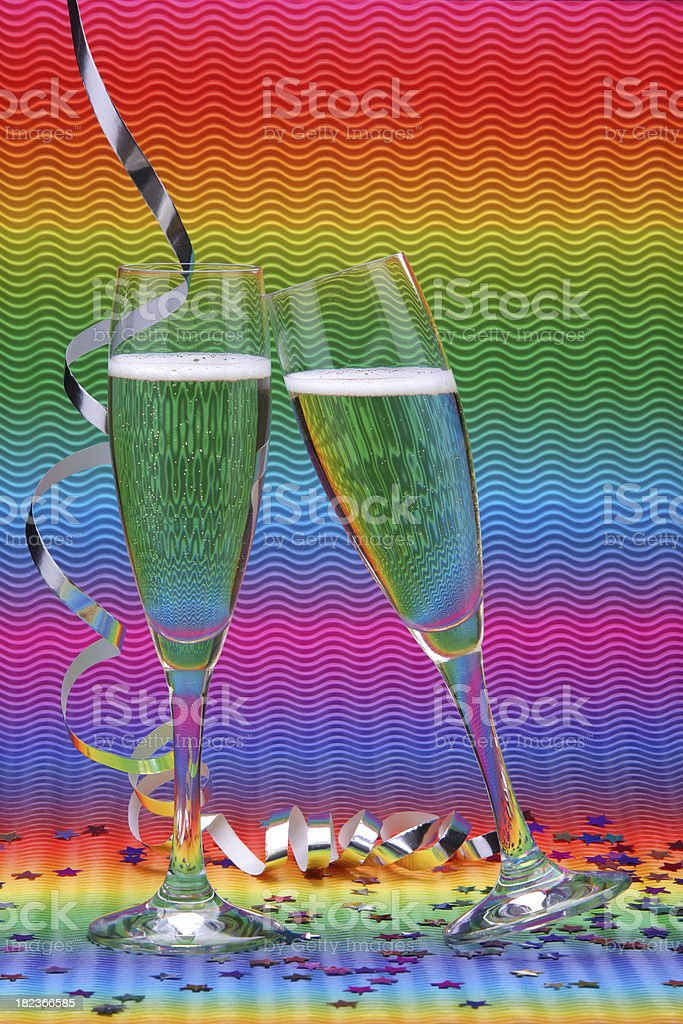Two glass glasses champagne colourful background (XXXL) royalty-free stock photo
