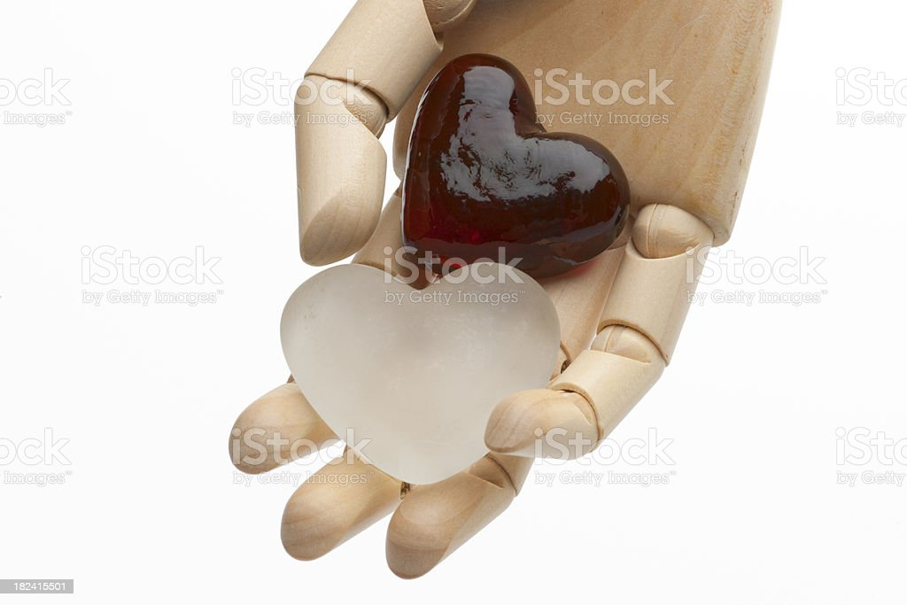 Two Glass Hearts in Hand Horizontal stock photo