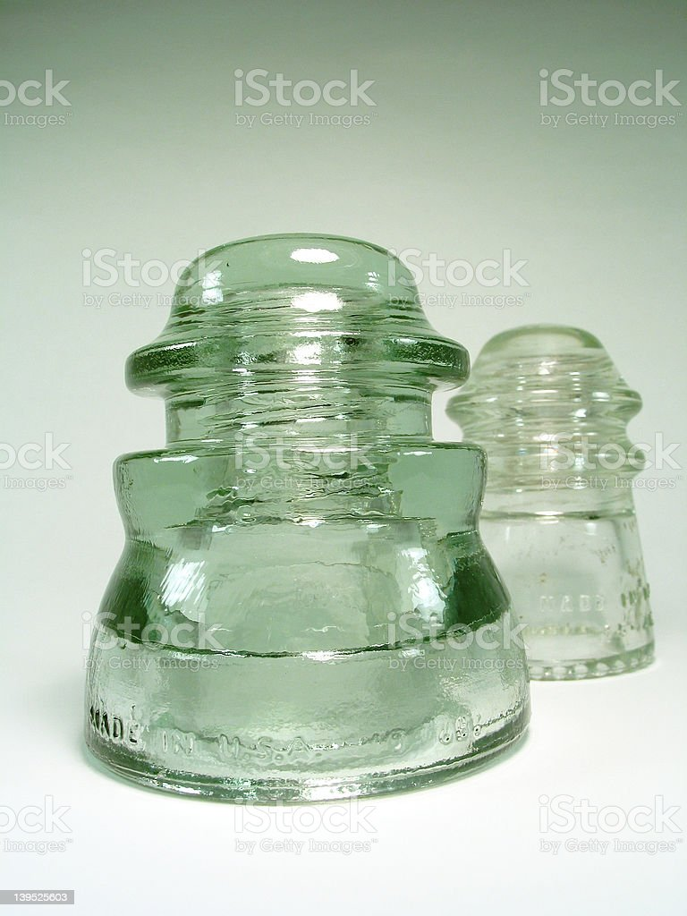 Two Glass Insulators royalty-free stock photo