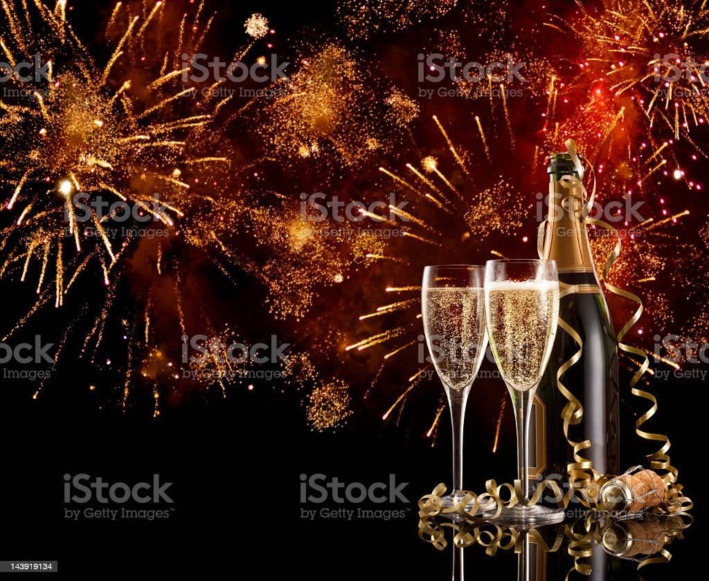 Two glasses and a bottle of champagne on New Years Eve stock photo