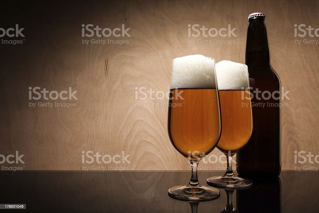 Two glasses and bottle with beer royalty-free stock photo