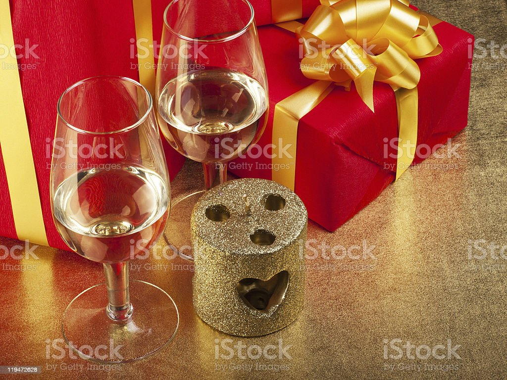 Two glasses and box with gifts stock photo
