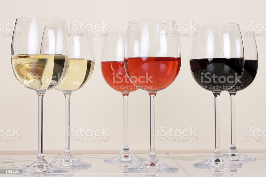Two glasses each of both Red, white and Rose wine royalty-free stock photo