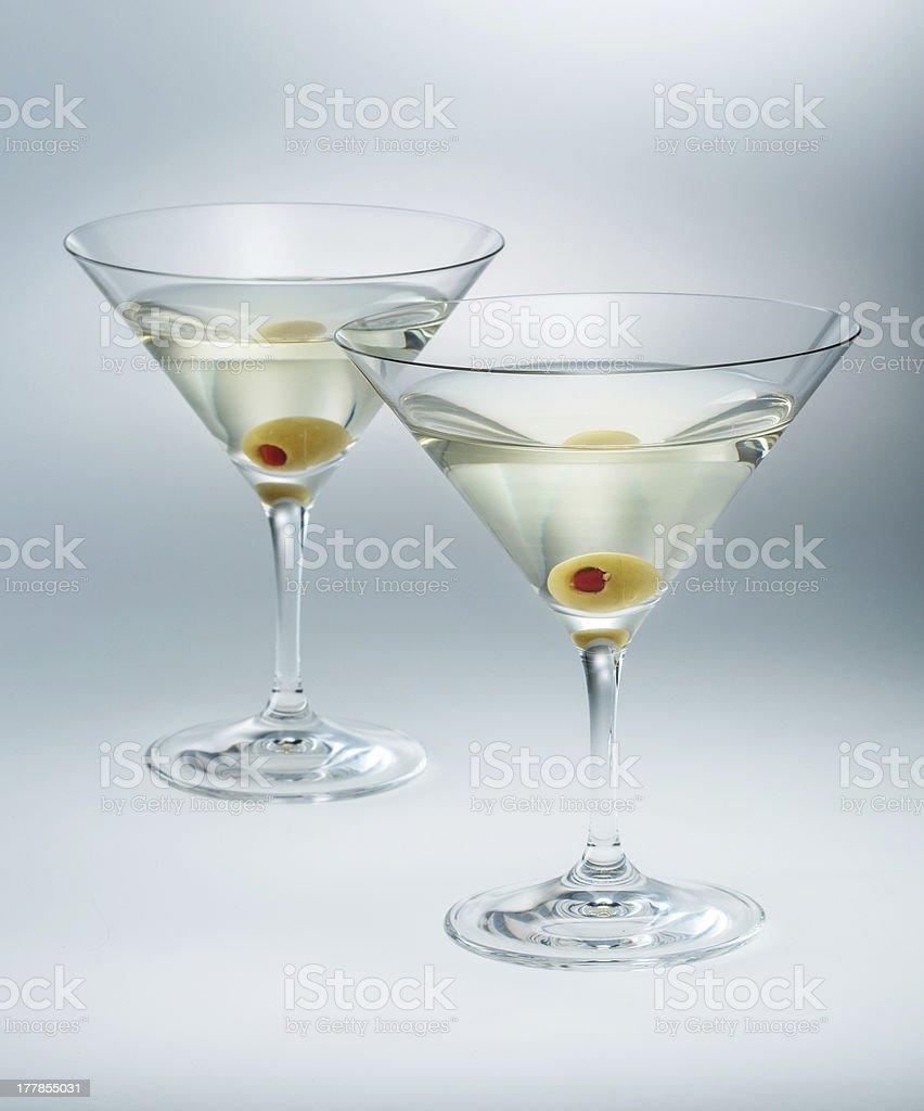 two glasses martini with olive. cocktail isolated stock photo