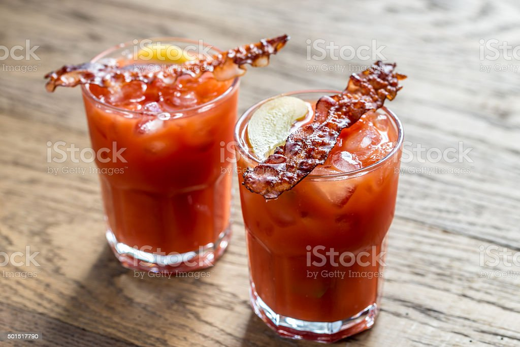 Two glasses of Bloody Mary with bacon rashers stock photo