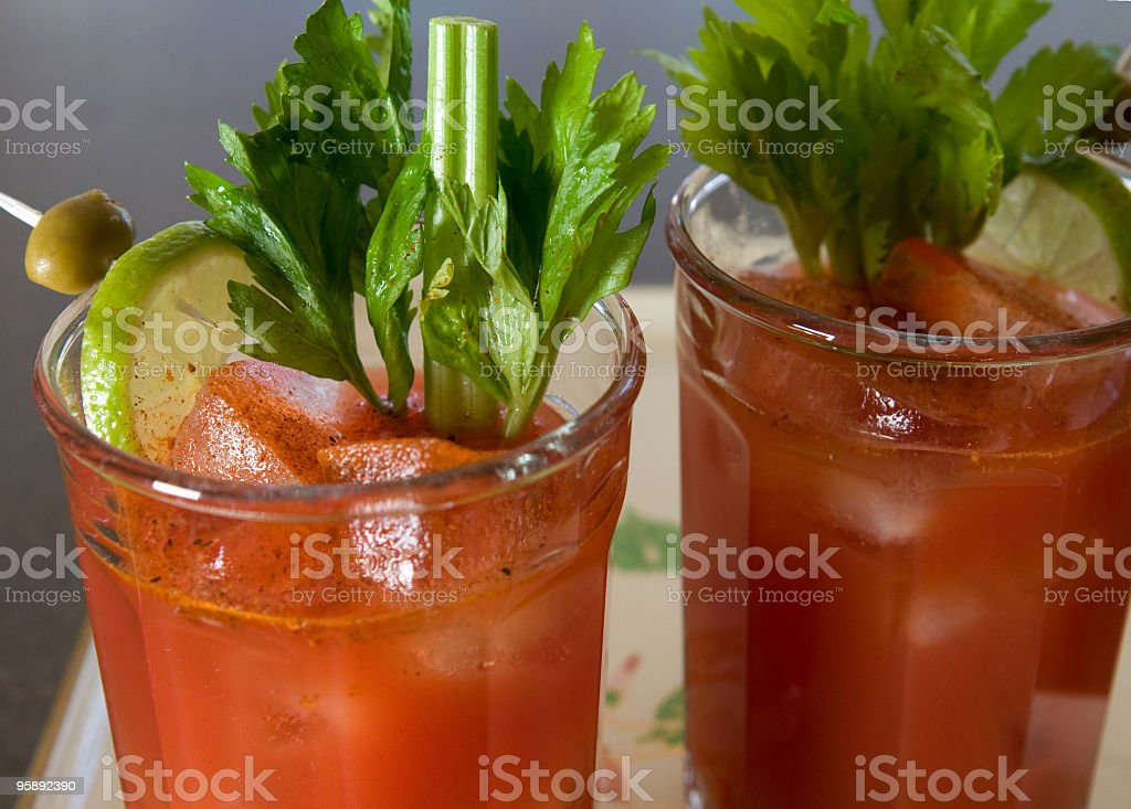Two glasses of Bloody Mary's with celery and other garnish stock photo