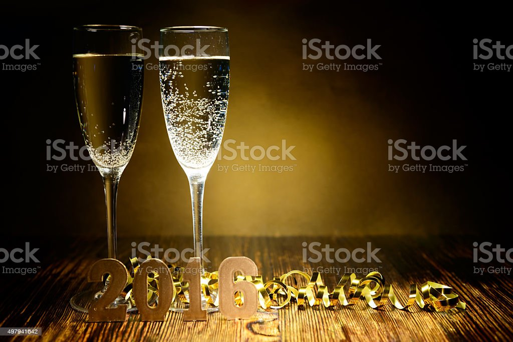 Two glasses of champagne and gold figures 2016 stock photo
