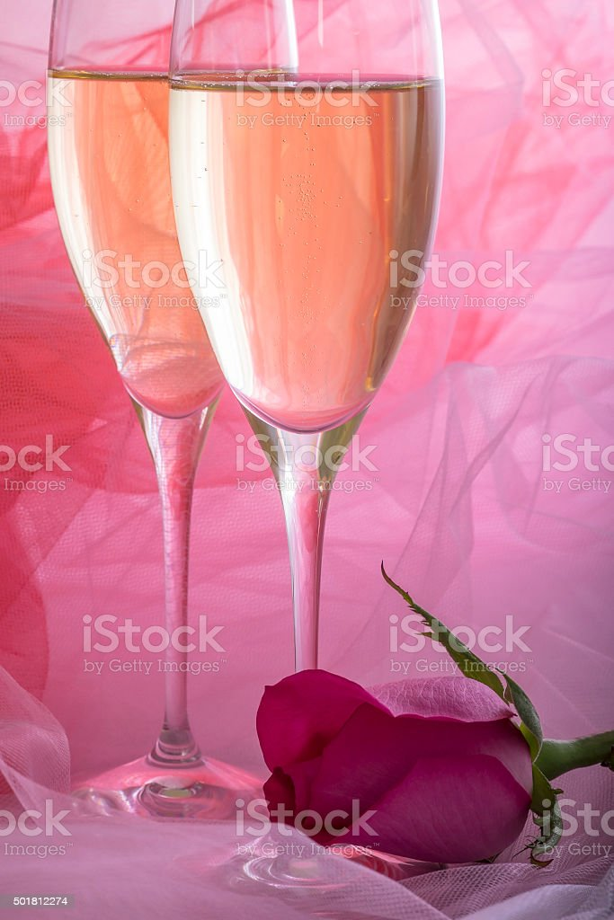 Two Glasses of Champagne and One Pink Rose stock photo