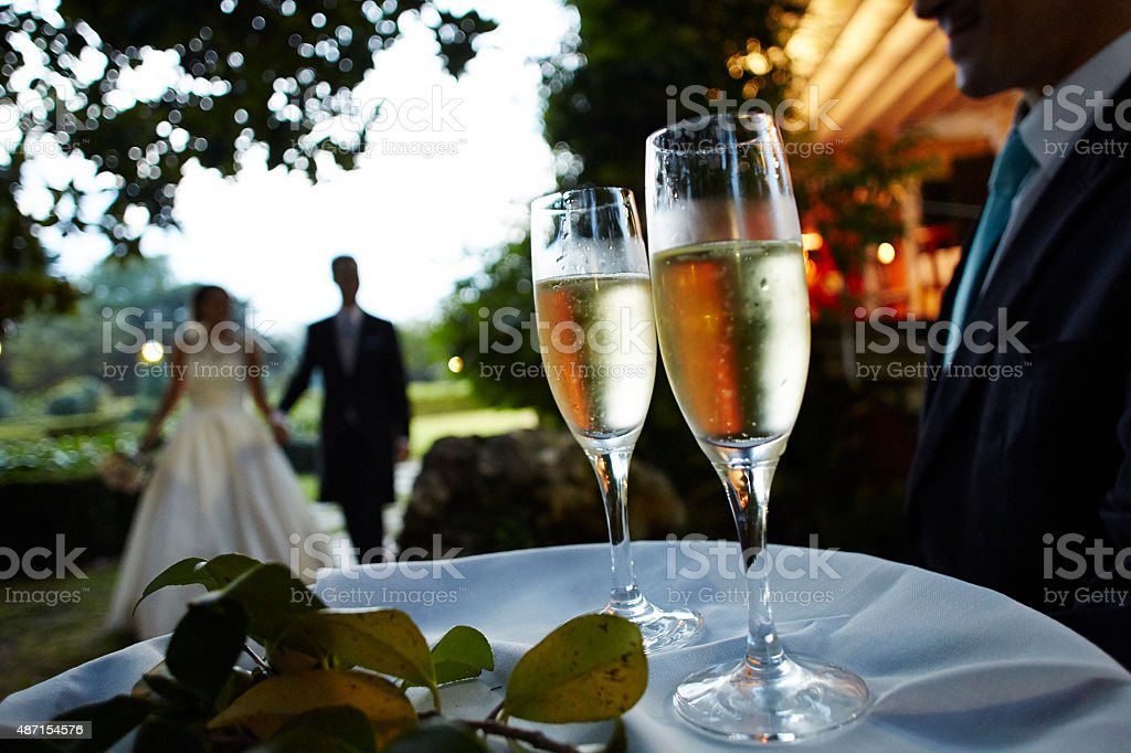 Two glasses of champagne for the bride and groom stock photo