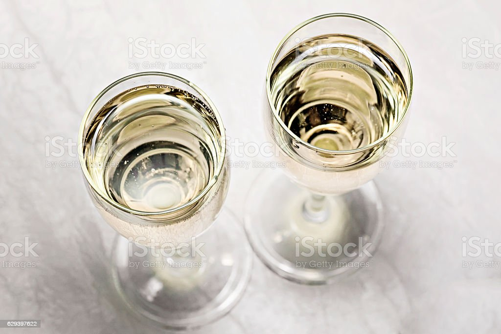 two glasses of champagne in a close-up top view stock photo