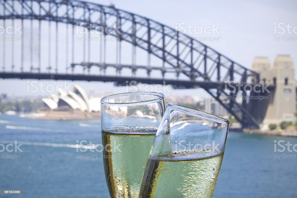 Two glasses of champagne in front of Sydney Harbour bridge stock photo