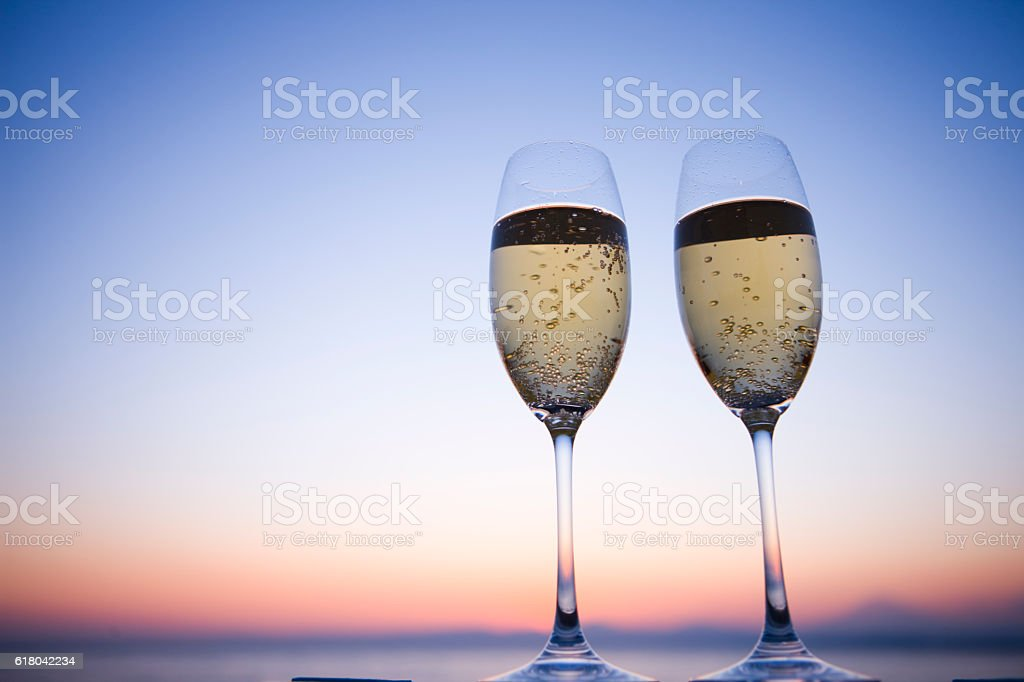 Two glasses of Champagne in twilight stock photo