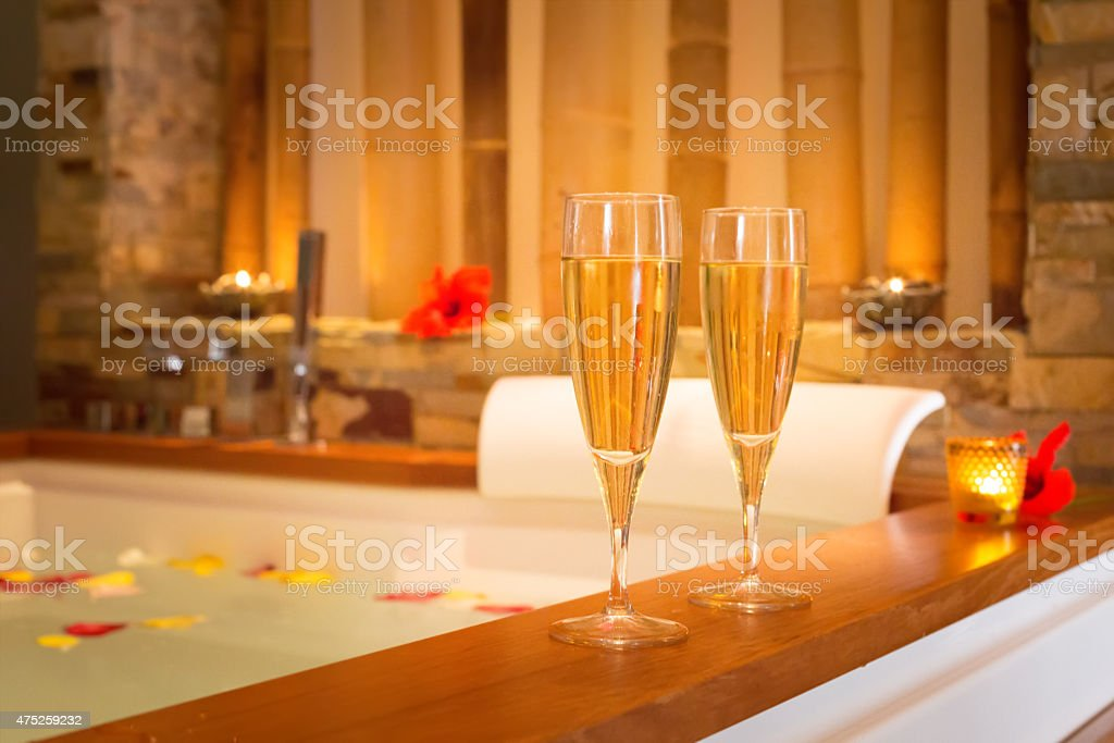 Two glasses of champagne near jacuzzi stock photo