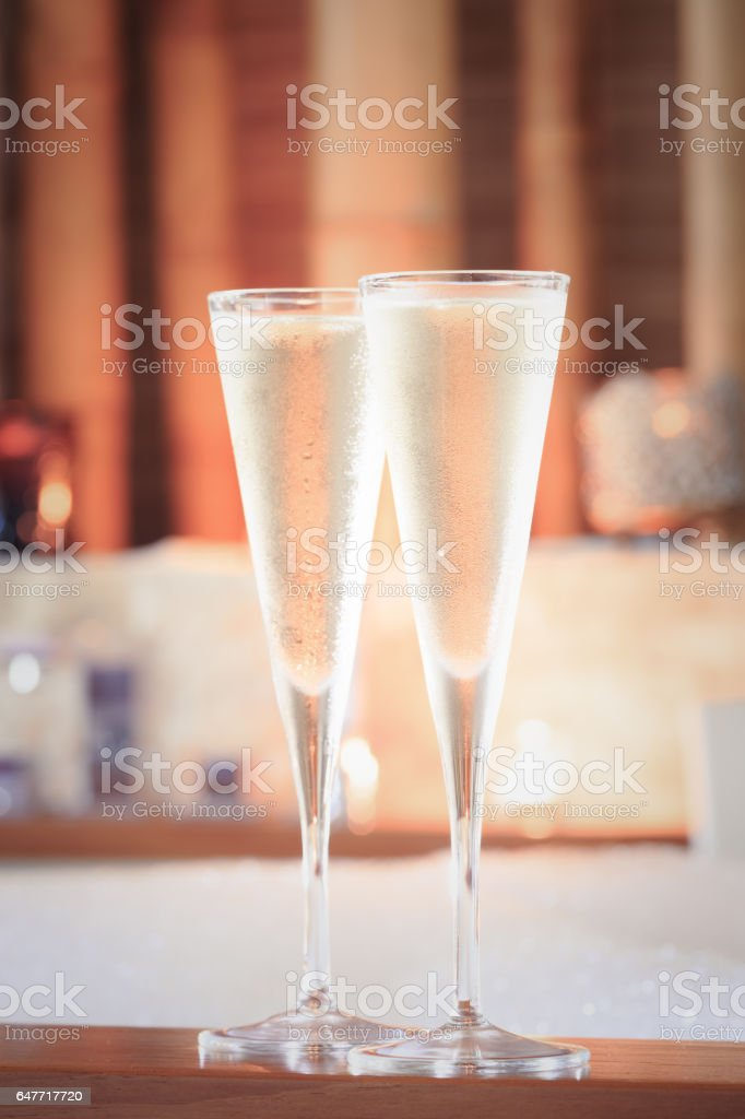 Two glasses of champagne near jacuzzi. Valentines background. Romance concept stock photo