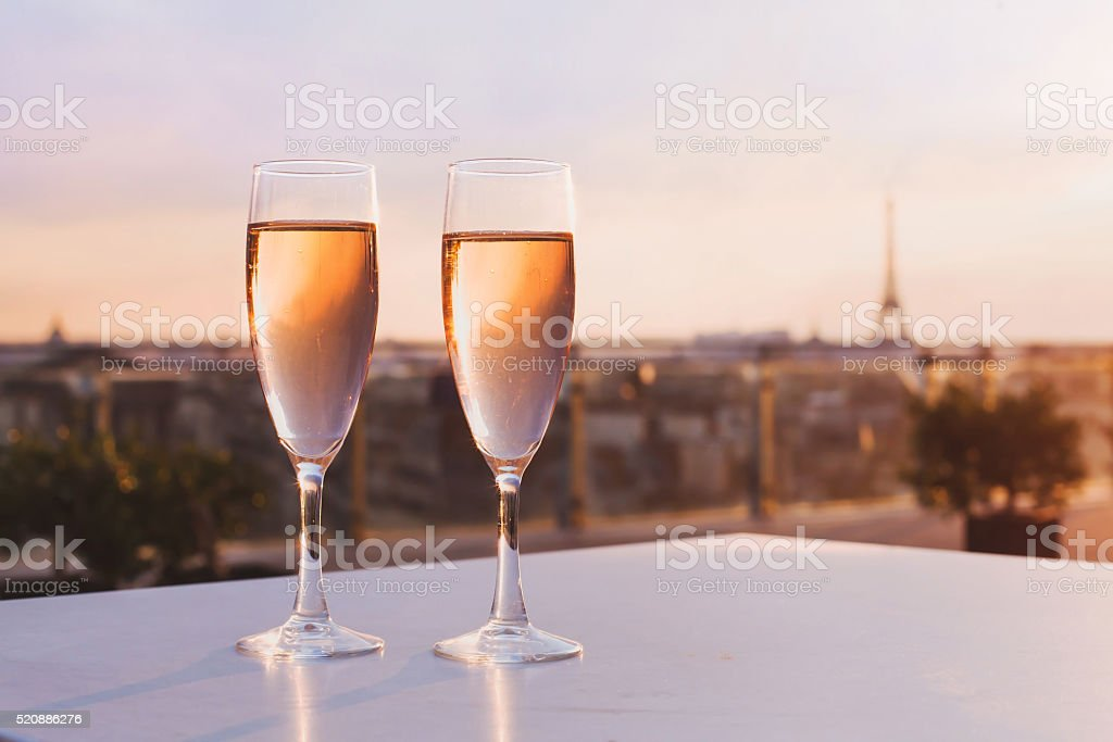two glasses of champagne on Eiffel tower background stock photo