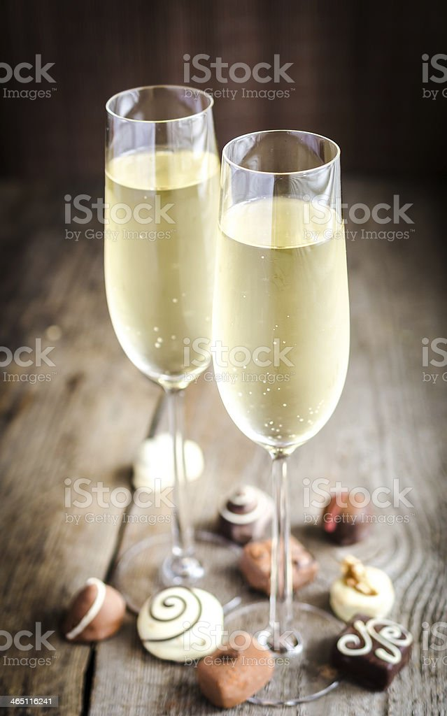Two glasses of champagne with candies royalty-free stock photo