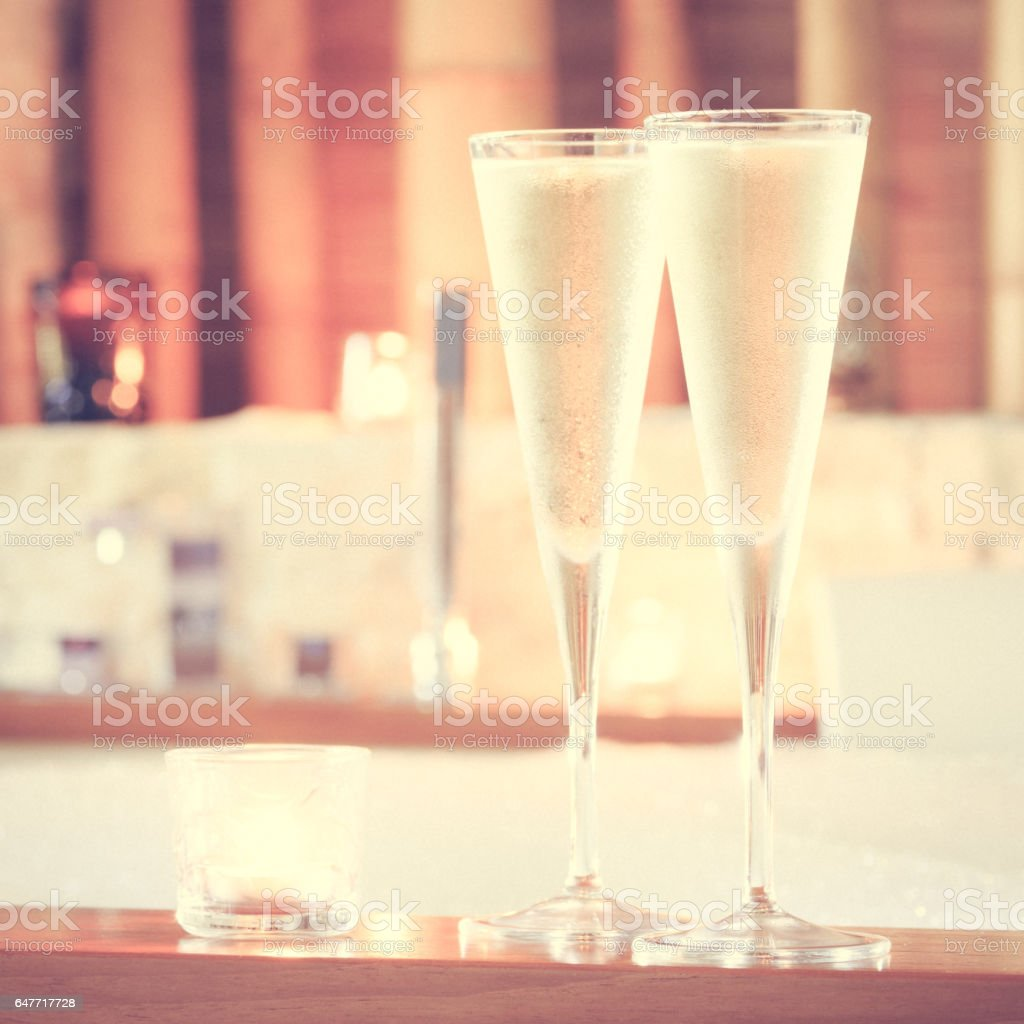Two glasses of champagne with candle near jacuzzi. Valentines background. Romance concept stock photo