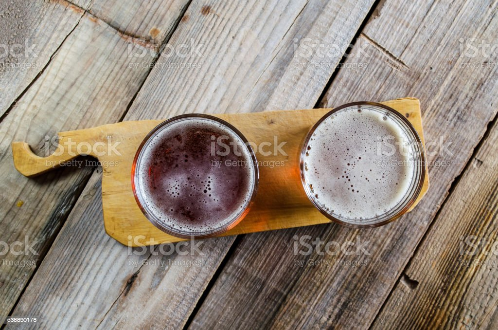 Two glasses of dark amber beer stock photo