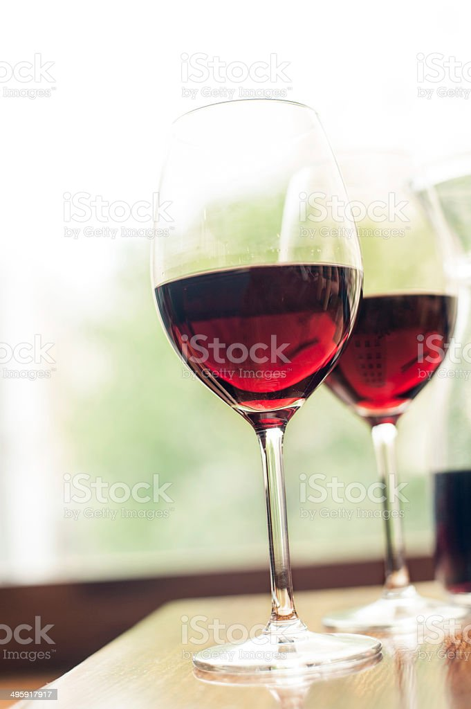Two glasses of delicious red wine. Indoors. stock photo