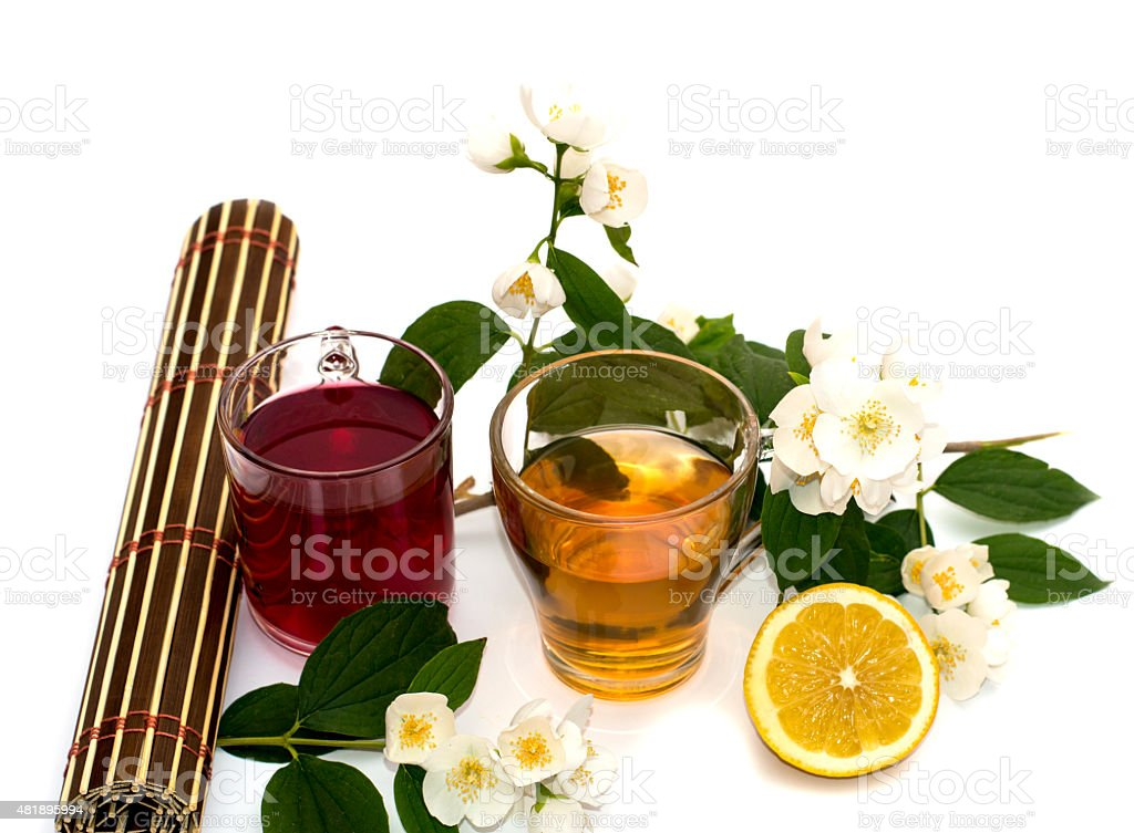 two glasses of drink and lemon on a white background stock photo
