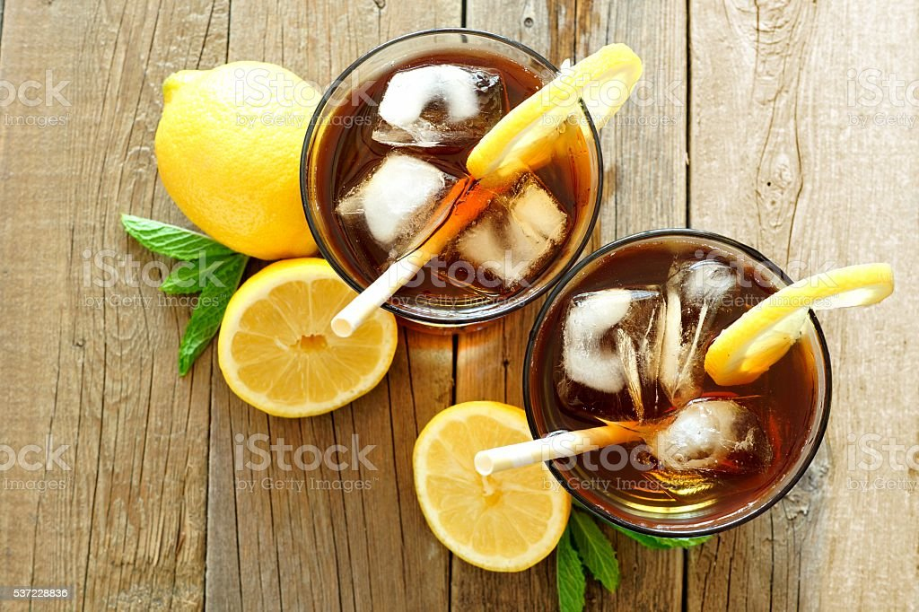 Two glasses of iced tea, overhead view on wood stock photo