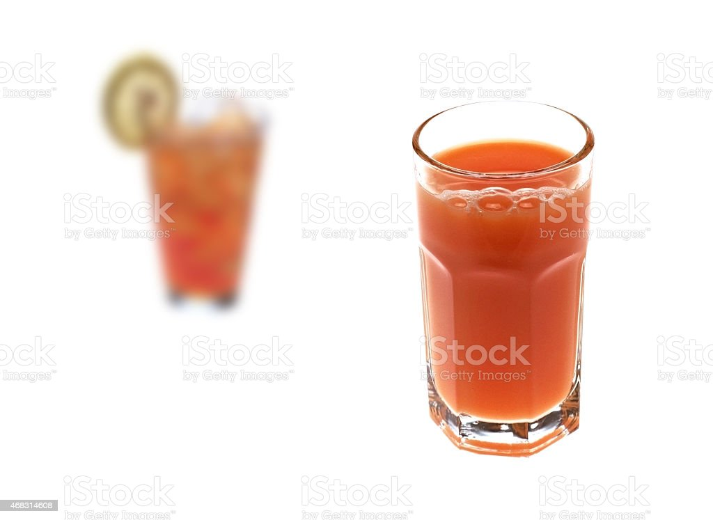 two glasses of juice with tomato stock photo