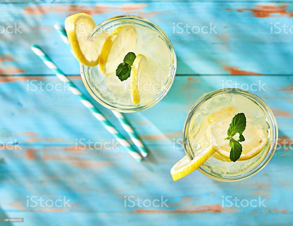 two glasses of lemonade shot from overhead stock photo