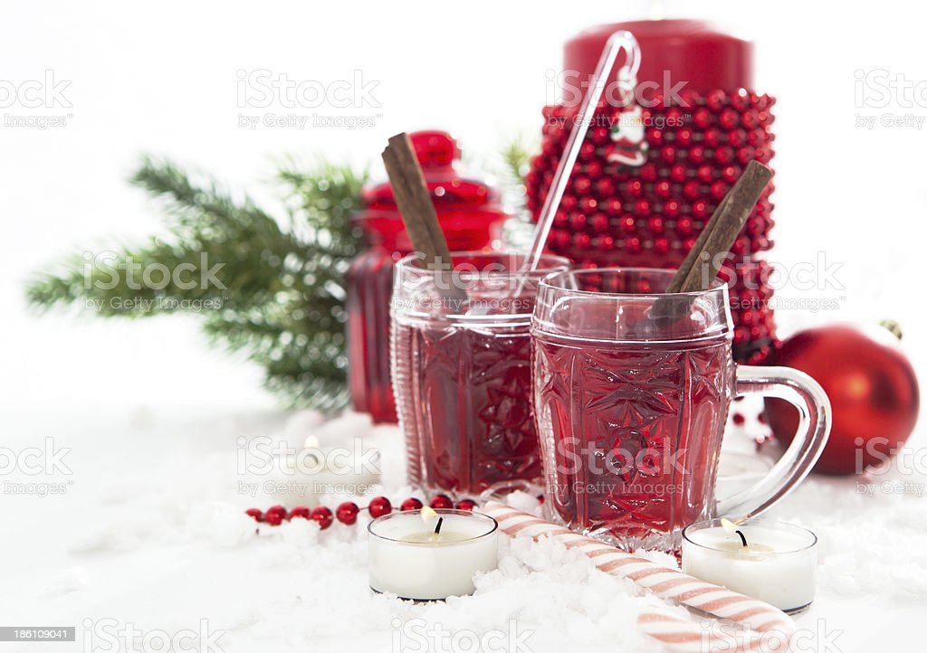 Two glasses of mulled wine and candle with Christmas decorations royalty-free stock photo