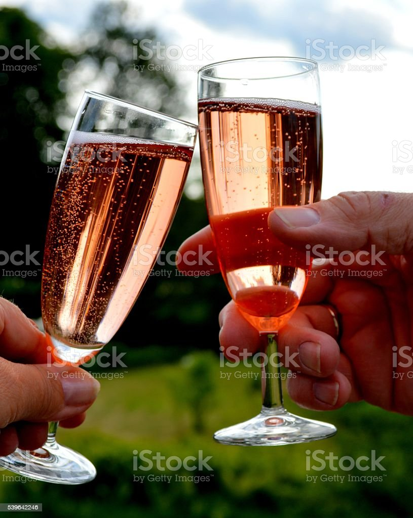 Two glasses of pink Champagne stock photo
