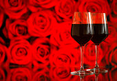 Two glasses of red wine against bokeh background