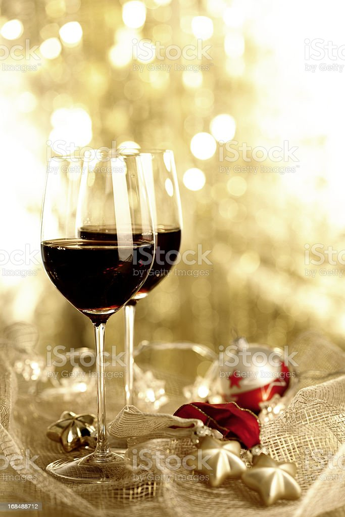 Two glasses of Red Wine and Christmas Ornaments royalty-free stock photo