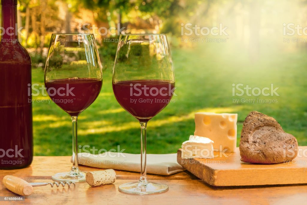 Two glasses of red wine at picnic with copyspace stock photo