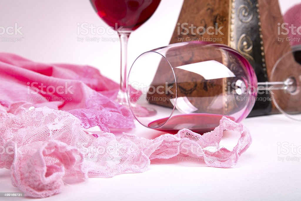 two glasses of red wine of about pink pant stock photo