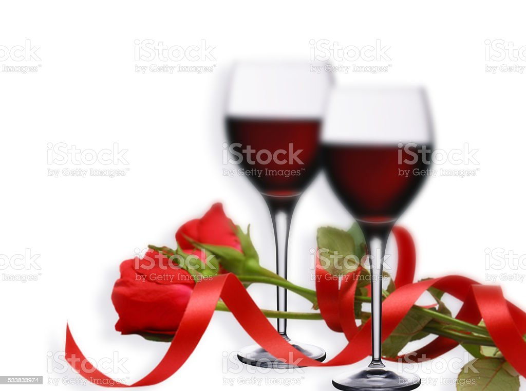 Two glasses of red wine with a red roses stock photo