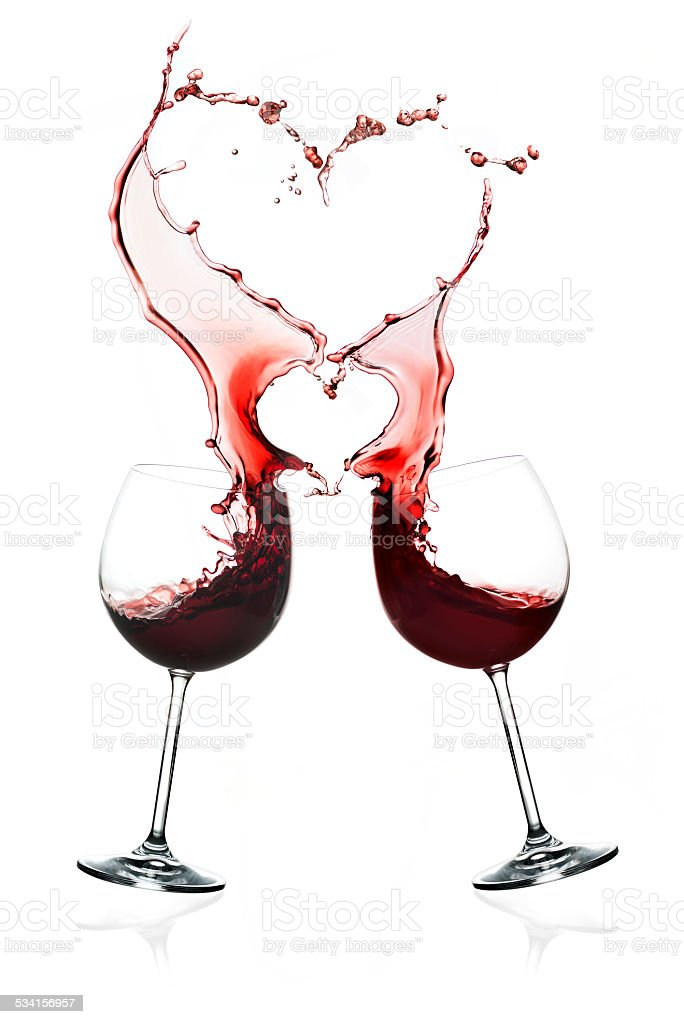 Two glasses of red wine with doubles hearts splashes stock photo
