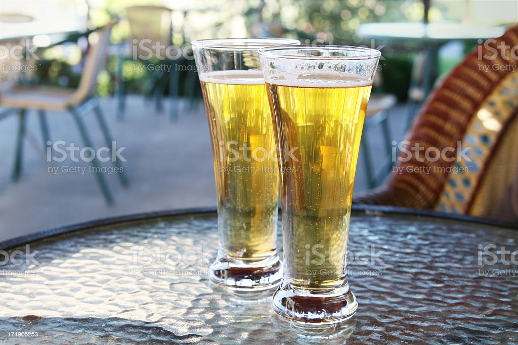 Two glasses of refreshing beer royalty-free stock photo