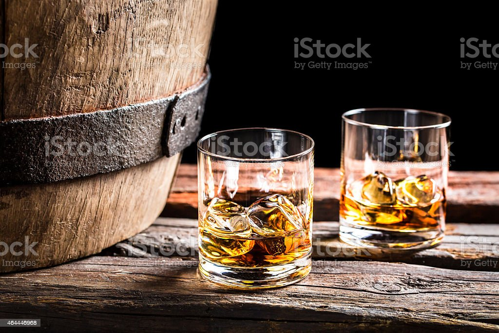 Two glasses of Scotch in the old cellar stock photo