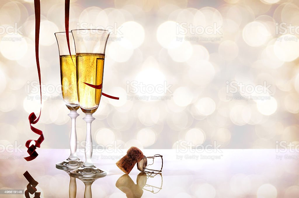 Two glasses of sparkling white wine and cork horizontal stock photo