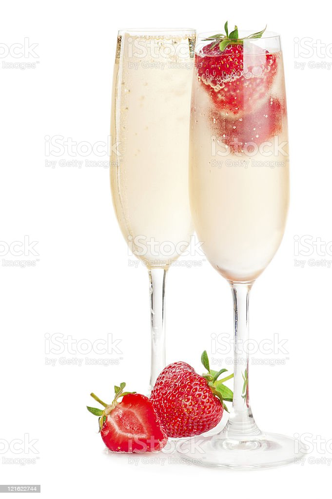 Two glasses of sparkling wine (champagne) and strawberry royalty-free stock photo