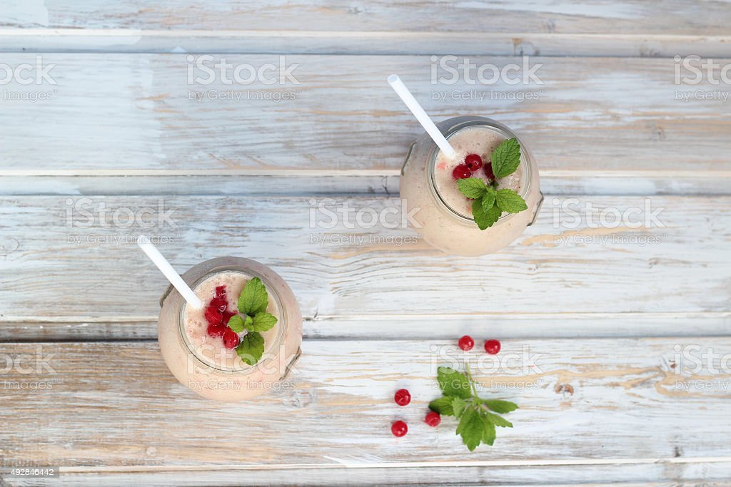 Two glasses of strawberry smoothie  on a wooden table royalty-free stock photo