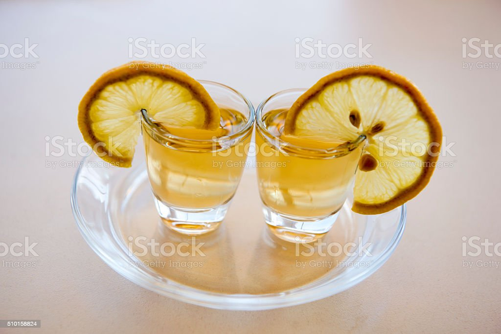 two glasses of tequila, salt and lime stock photo