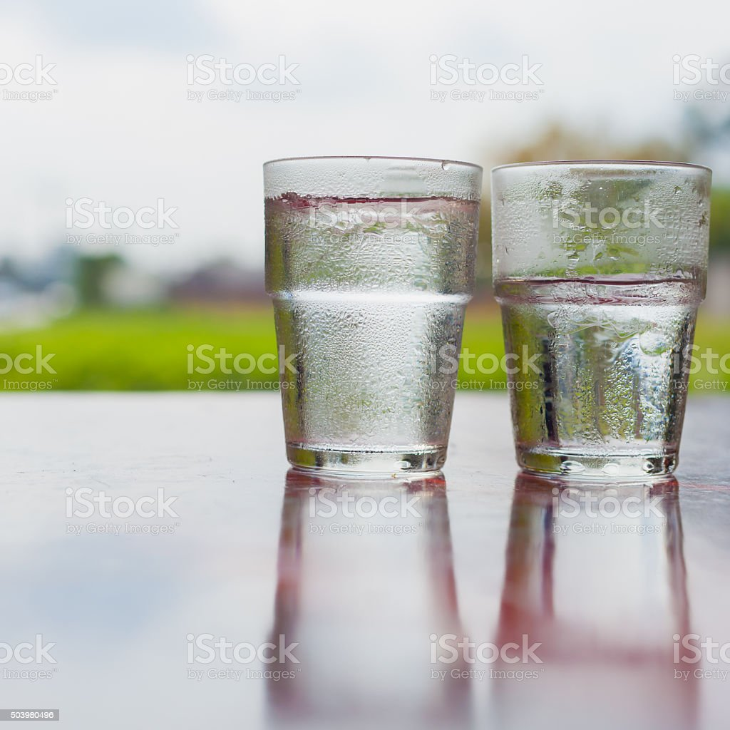 Two glasses of water on the table. stock photo
