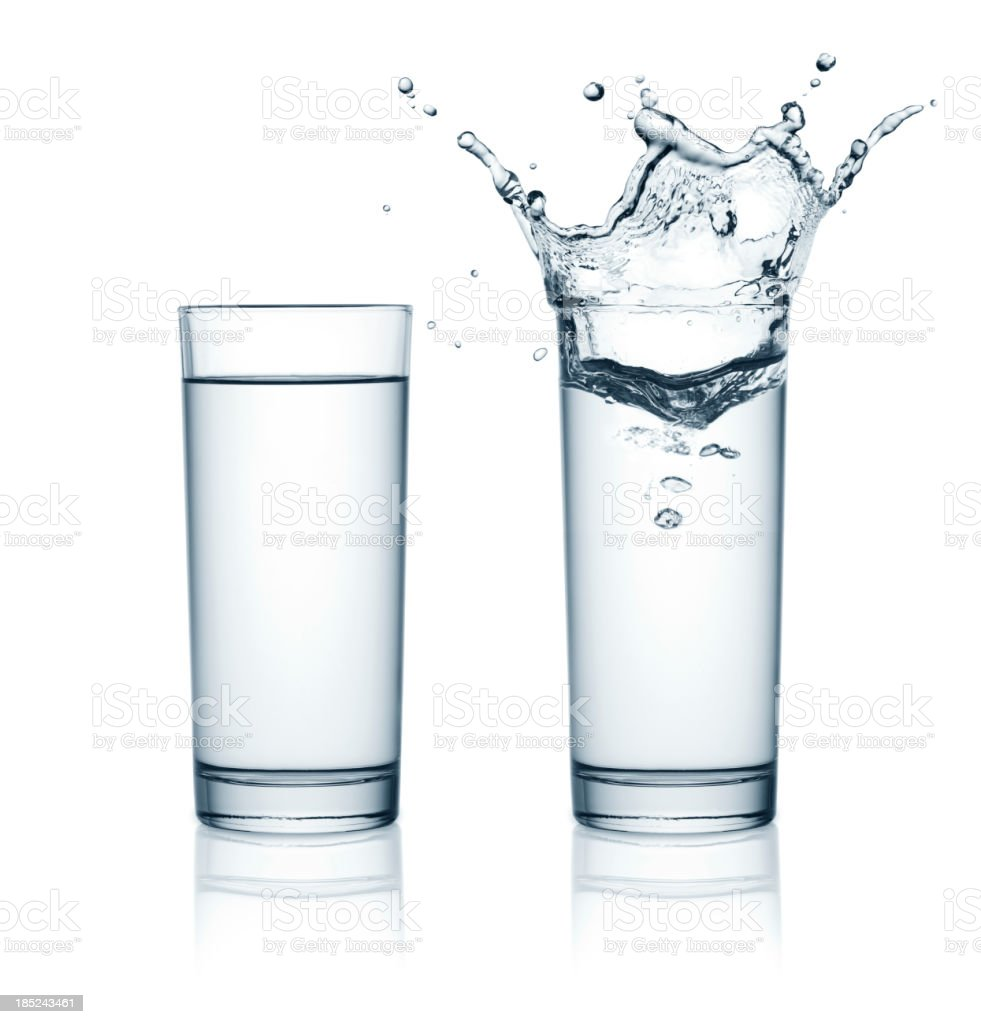 Two glasses of water, one with splashes stock photo