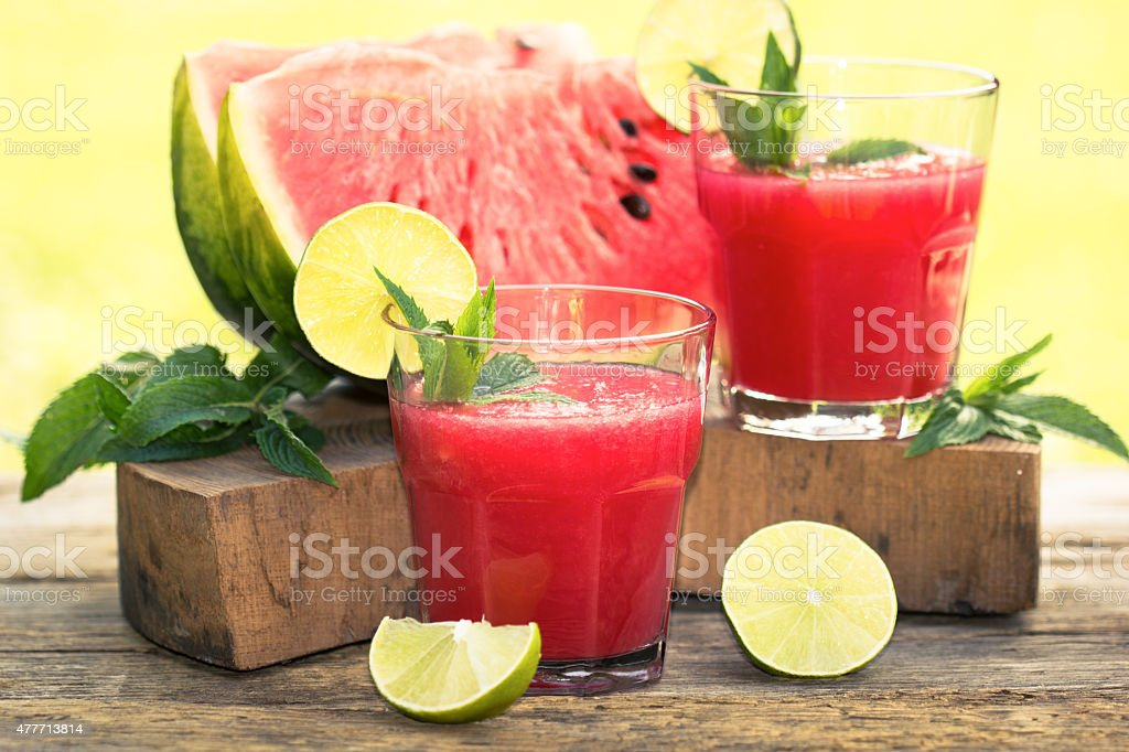 Two glasses of watermelon smoothies with lime and mint stock photo
