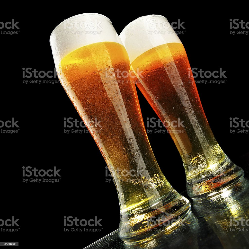 Two glasses of wheat beer on black background royalty-free stock photo