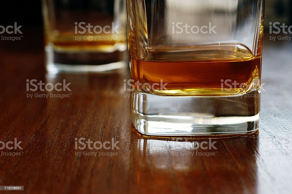 two glasses of whiskey on a dark table royalty-free stock photo
