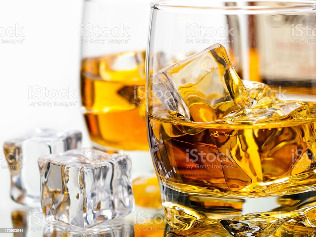 Two glasses of whiskey on the rocks stock photo